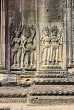 The image of people on a stone slab. Cambodia Siem Reap Angkor Thom Stock Photo