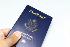 Image of a persons hand holding a passport Royalty Free Stock Photo