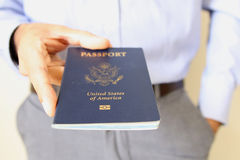 Image of a persons hand holding a passport Royalty Free Stock Photography