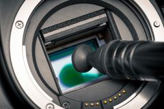 Image photo sensor being cleaned with a lens pen. DSLR APS-C Royalty Free Stock Image