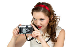 Image of the photographing woman with retro camera Stock Photo