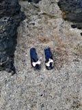 Flip-flops in sand on the beach stock photo