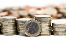 Image of pile of Euro coins with cent coins in the background close up stock photography