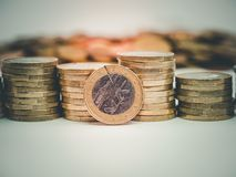 Image of pile of Euro coins with cent coins in the background close up stock photos
