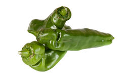 Image of a pile of organic green peppers over a wh. Ite background Stock Photos