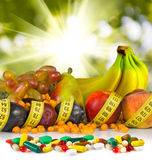 Image of pills on a background of fruits close-up Royalty Free Stock Images