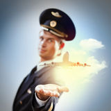 Image of pilot with plane in hand Stock Photos