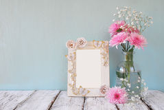 Image of pink and white flowers and antique frame on wooden table. template, ready to put photography Stock Photos