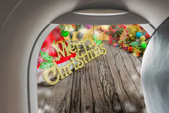 Image of plane window and Christmas ornaments. On wood background Stock Photos