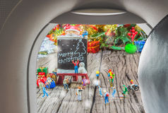 Image of plane window and Christmas ornaments. On wood background Royalty Free Stock Photography