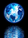 Image of the planet earth in the reflection of water close-up. Image of the planet earth in the reflection of water Stock Photography