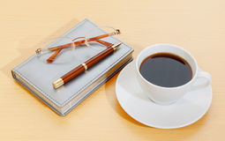 Image of planner , coffee cup pen and glasses Stock Image
