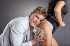 Image of pleased man hugging sexy stripper Royalty Free Stock Photography