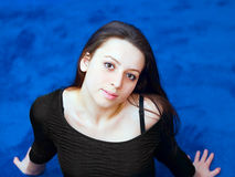 Portrait of a young girl on blue background Royalty Free Stock Image
