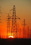 Power transmission tower. Image of power transmission tower with cables in bright tones royalty free stock photo