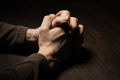 Image of praying hands. Of a man Stock Image