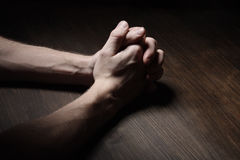 Image of praying hands. In the dark Royalty Free Stock Photo