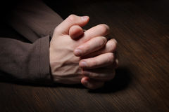 Image of praying hands. In the dark Stock Images