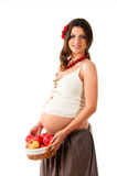 The image of a pregnant woman. The image of a pregnant woman with a basket of apples Stock Images