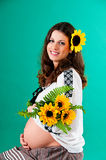 The image of a pregnant woman. With sunflower. Ethnic style Royalty Free Stock Image