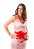 The image of a pregnant woman. We are waiting for a gift. Bow on his tummy Royalty Free Stock Images