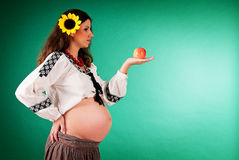 The image of a pregnant woman with sunflower. Ethnic style Royalty Free Stock Images