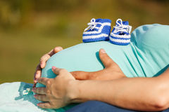 Image of pregnant woman touching her belly with hands Stock Images
