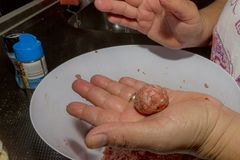 woman`s hands preparing meatballs in a kitchen royalty free stock photography