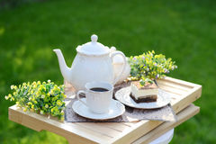 Image presenting a sweet brakfast. In the garden Royalty Free Stock Photography