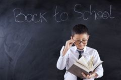 Preteen boy with book and text of back to school royalty free stock photography