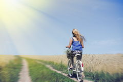 Image of pretty female travel with cycle on the Royalty Free Stock Photography
