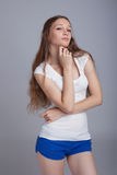 Image of pretty girl with sly look on her face Stock Images
