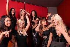 Image of pretty girls dancing in night club. Pretty girls dancing in night club Stock Photo