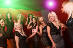 Image of pretty girls dancing in night club Royalty Free Stock Images