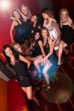 Image of pretty girls having fun in night club. Group of pretty girls having fun in night club Royalty Free Stock Photography