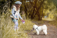 Image of pretty little girl playing with cute dog Stock Photos