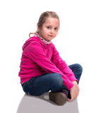 Image of a pretty little girl sitting on the floor Stock Images