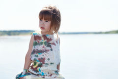 Image of pretty little model posing at lake Stock Photos