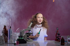 Image of pretty schoolgirl posing in chemistry lab Royalty Free Stock Photos