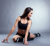 Image of pretty slim brunette doing stretching Stock Photography