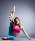 Image of pretty sportswoman doing stretching Stock Photography