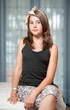 .Image of pretty teenager posing indoor in a good mood Royalty Free Stock Photo