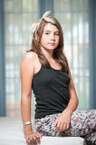 .Image of pretty teenager posing indoor in a good mood Stock Images