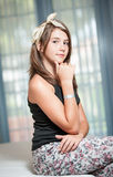 .Image of pretty teenager posing indoor in a good mood Royalty Free Stock Image