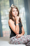 .Image of pretty teenager posing indoor in a good mood Stock Image