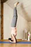 Yoga woman. An image of a pretty woman doing yoga at home - Salamba Shirshasana Stock Photography