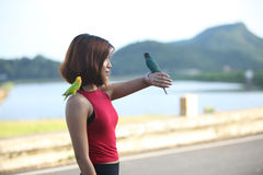Image of pretty woman pose and smile with green birds Stock Image