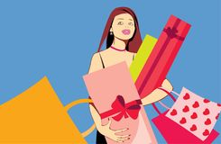 Pretty woman with bags. Image of pretty woman with presents after shopping isolated on blue Stock Images