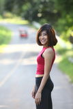 Image of Pretty women standing poses, smile down hill background Royalty Free Stock Photo