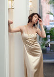Pretty Woman in Gold Stock Photos